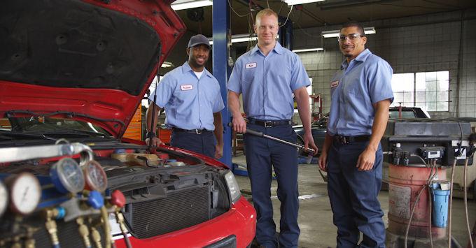 three men in auto shop